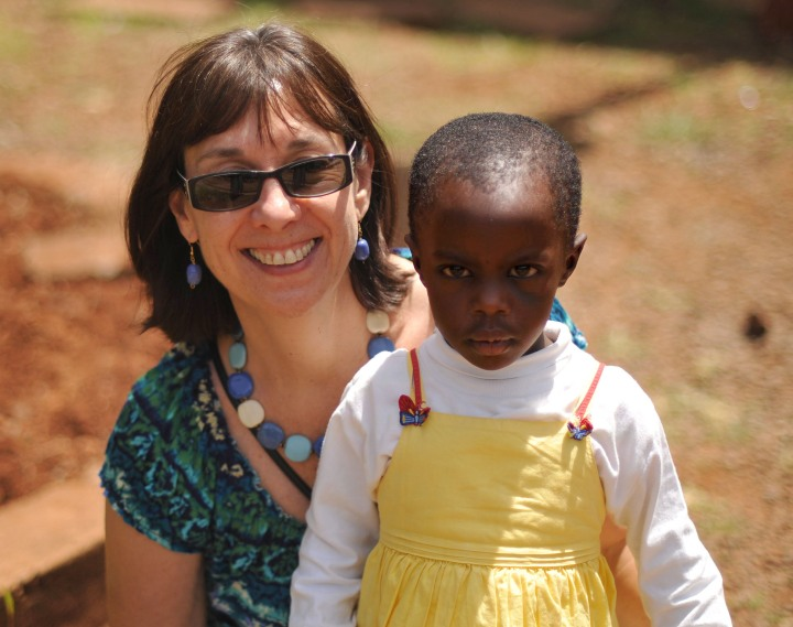 Deb with a child at the Children's Home