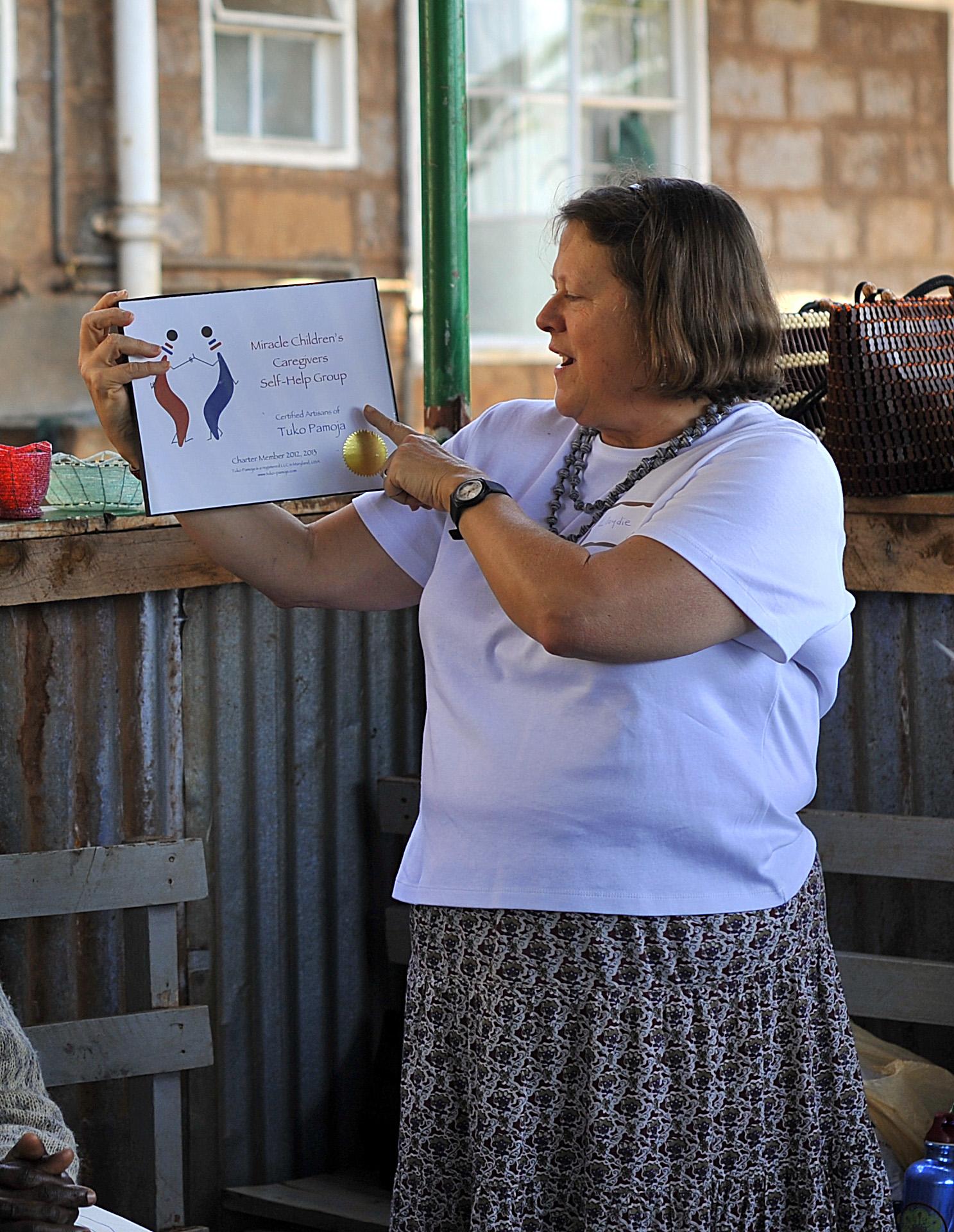 LLoydie showing the Tuko Pamoja certificate