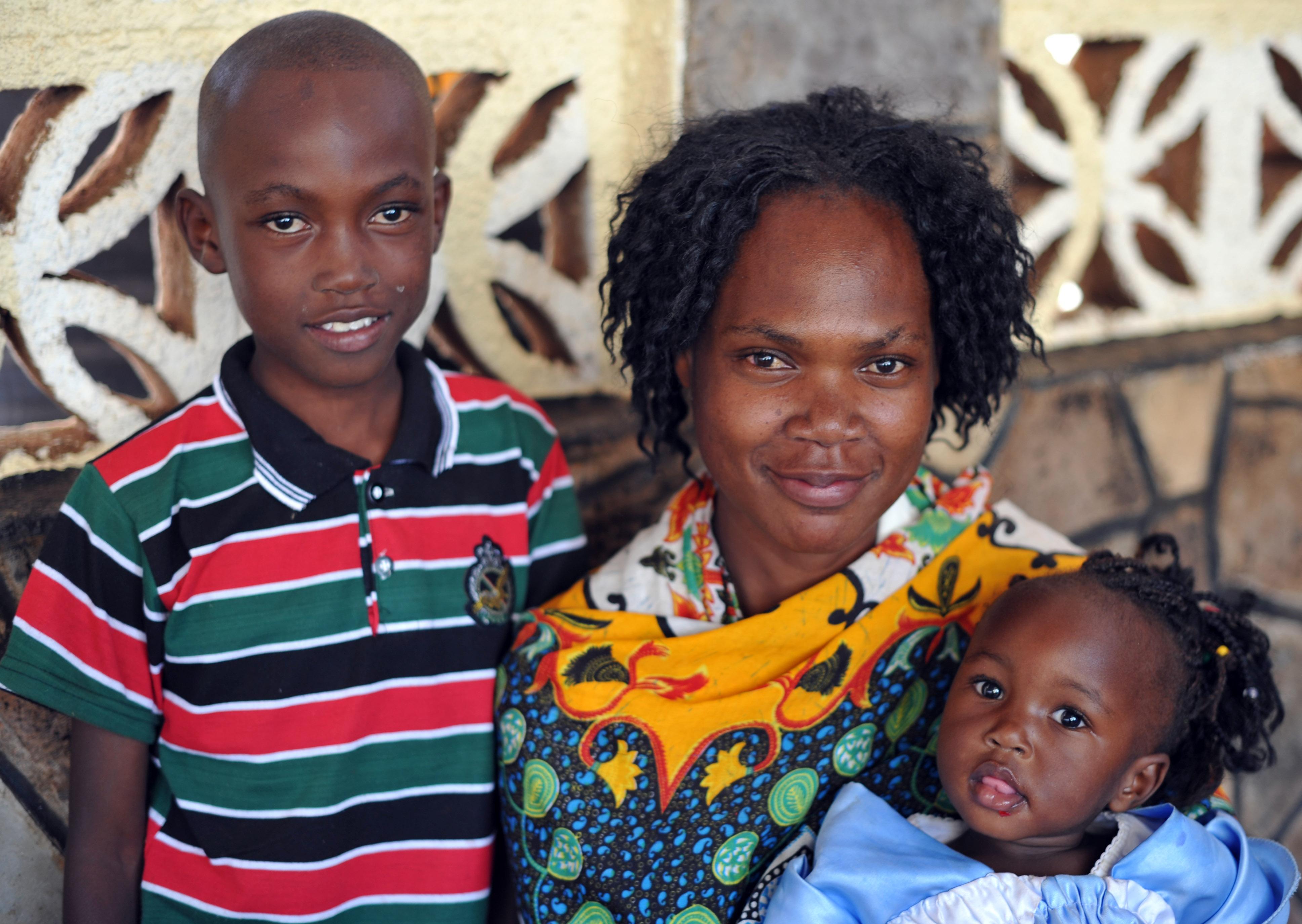 One of the Tuko Pamoja women and her children