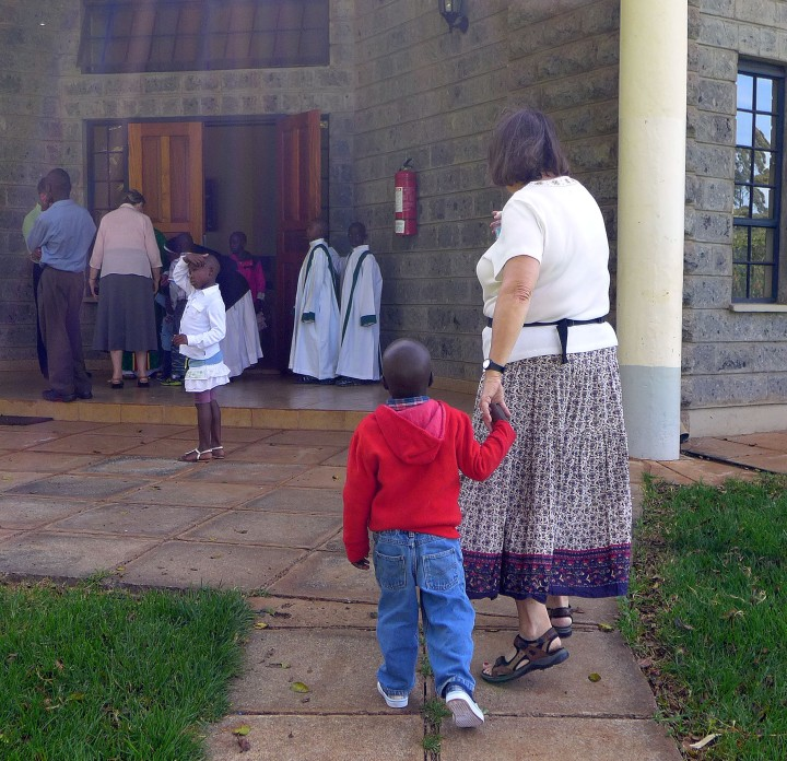 Lloydie with a child from Nyumbani Children's Home headed to church