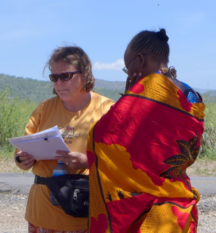Presenting the Tuko Pamoja certificate to PCDA