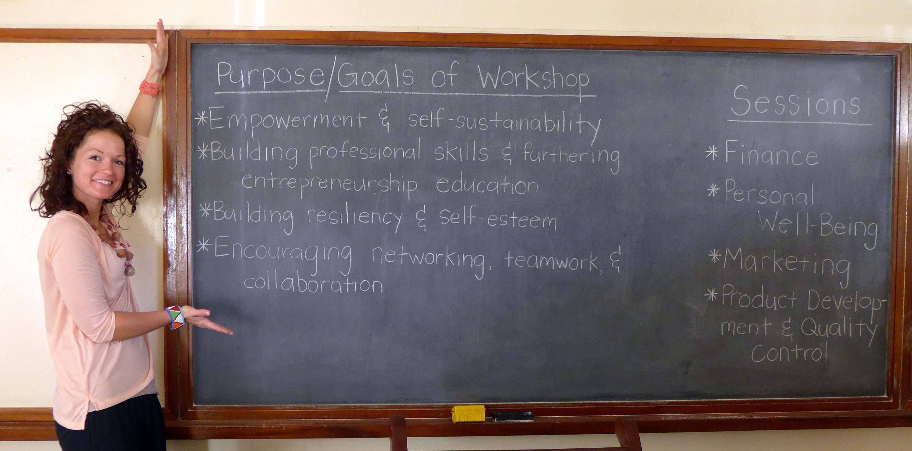 "Sarah ""posing"" with the goals and workshop session titles"