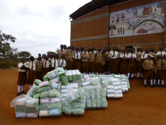 Delivering supplies to adolescent girls at Nyumbani Village
