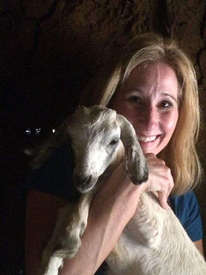 Judy holding a baby goat